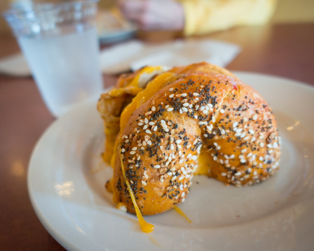 High Rise Bakery's Egg and Cheese on the Red Chile Bagel with cheese dripping
