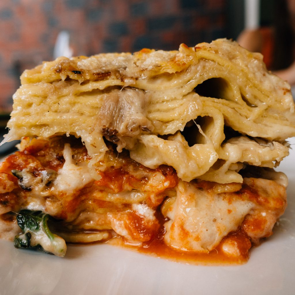 North and South Lasagna Slices Stacked at Basta