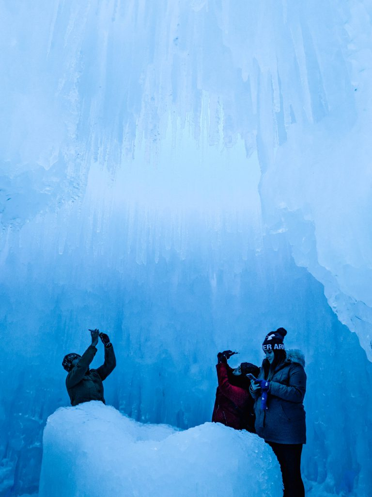 People taking photos in Dome Room. Ice Castles Dillon