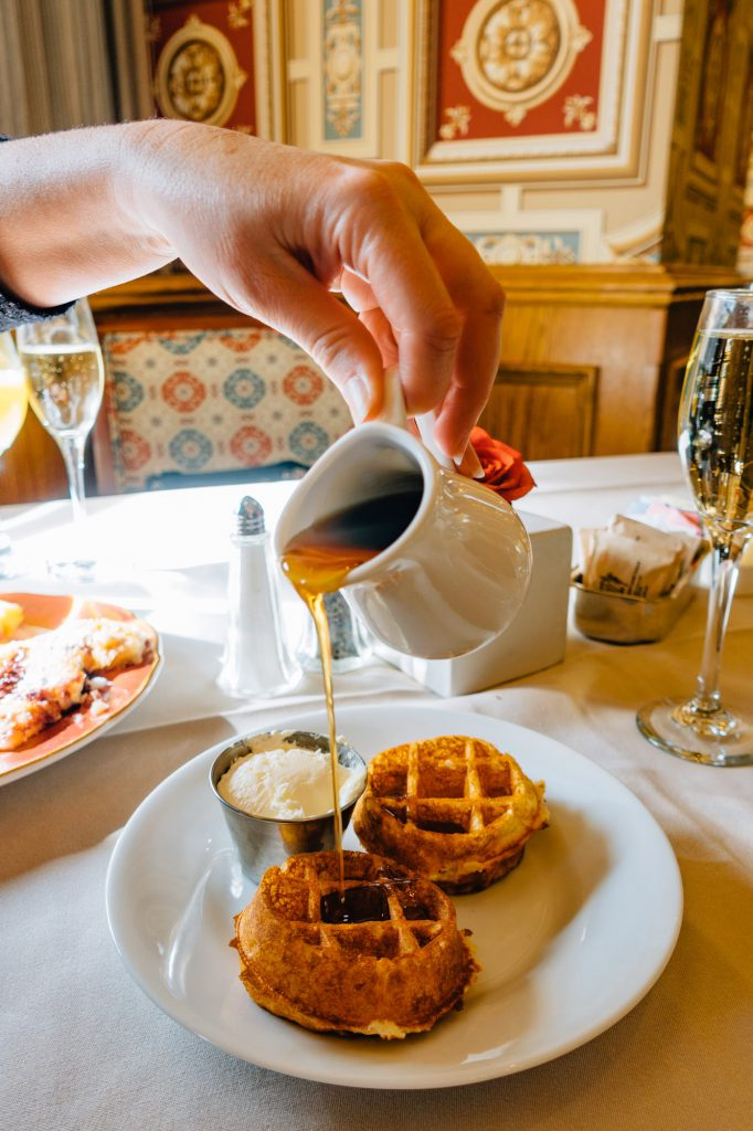 Mini waffles with syrup being poured over