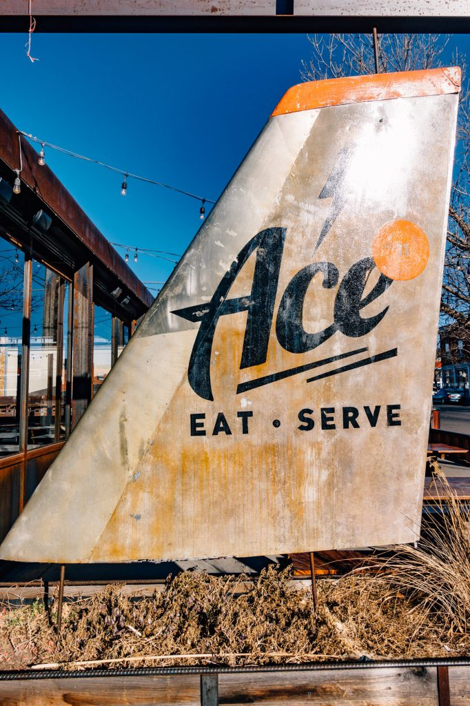 Ace Eat Serve exterior plane sign