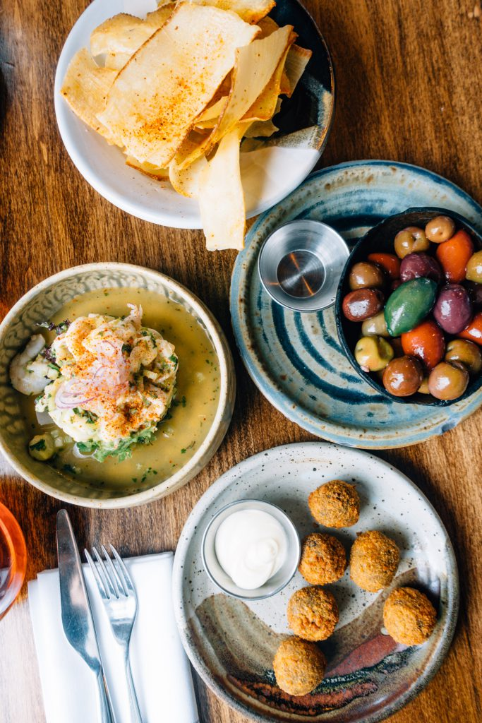 Ceviche, olives, and croquetas at Pinch Kitchen Miami