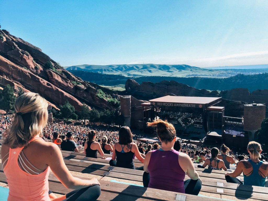 Yogis meditating at Yoga on the Rocks at Red Rocks Amphitheater