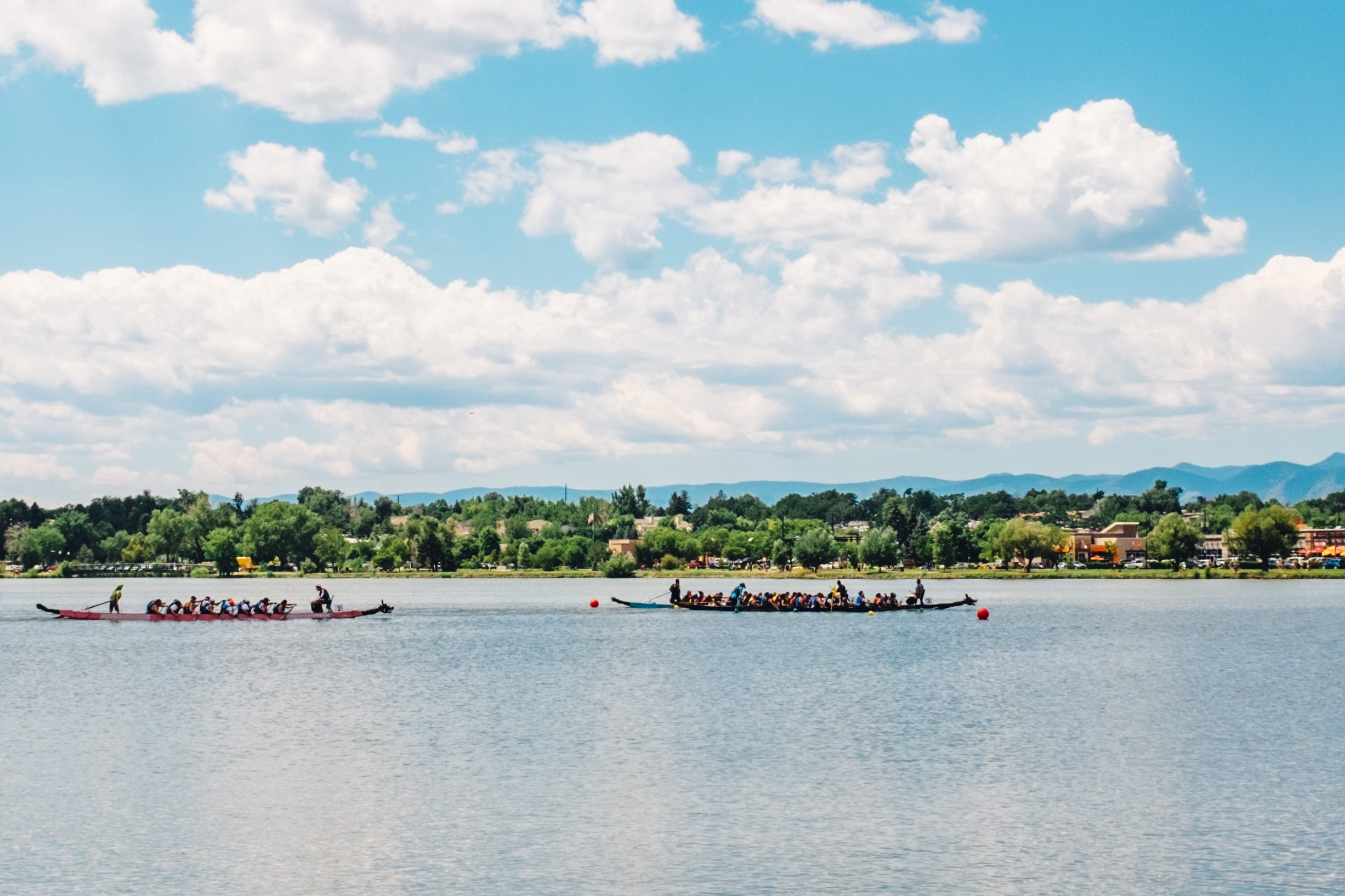 Boats racing at the Colorado Dragon Boat Festival