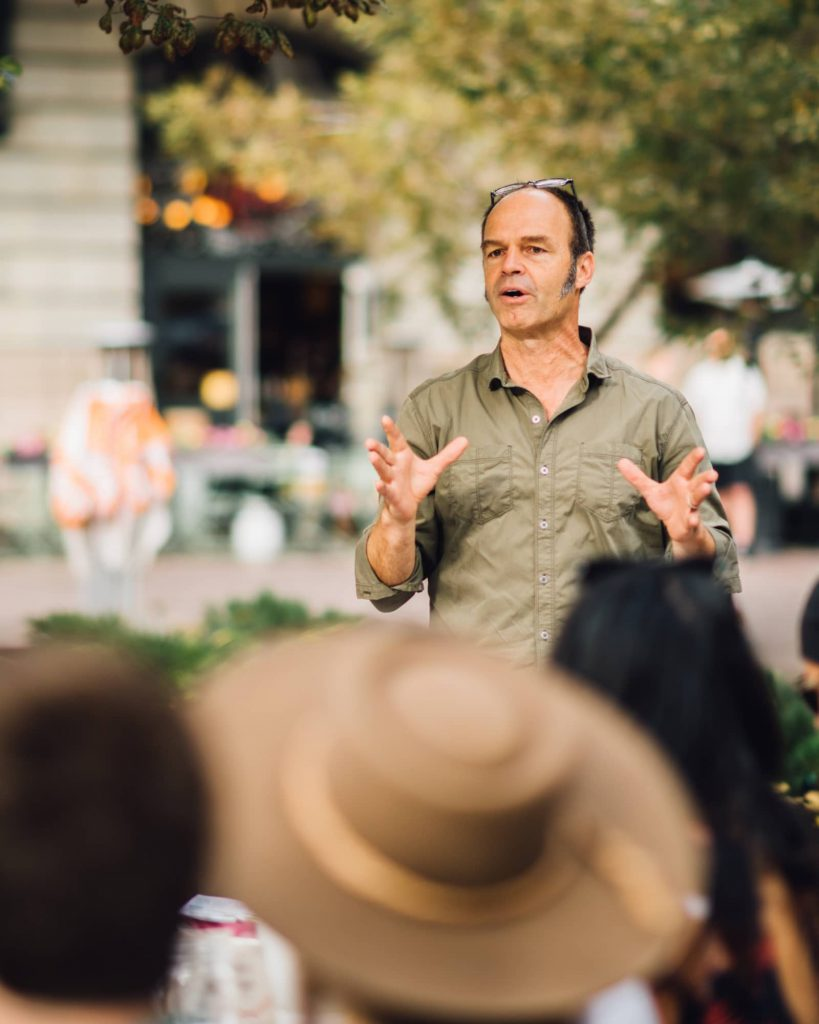 Boulder County Farmers Market Executive Director Brian Coppom speaks to diners