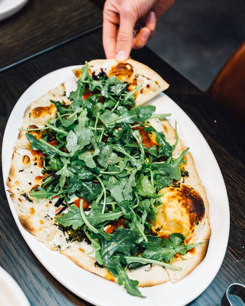 Charred Broccolini Flatbread at Woodie Fisher