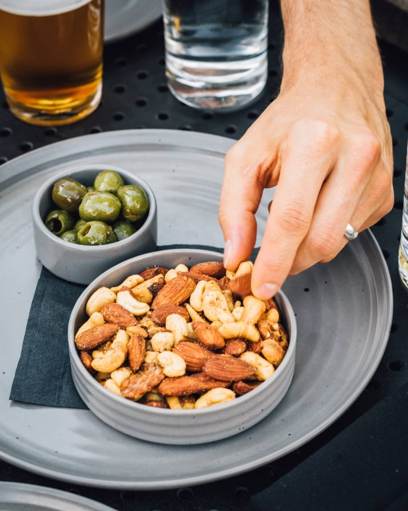 Bowl of nuts and olives at American Elm